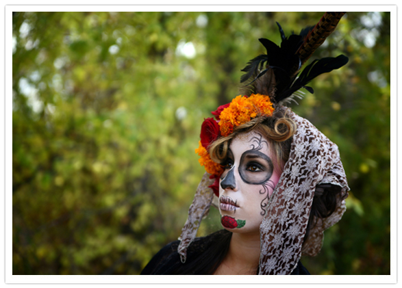 Day of the Dead sugar skull makeup model wearing a veil and marigolds